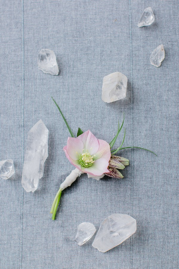 Hellebore buttonhole surrounded by quartz crystal