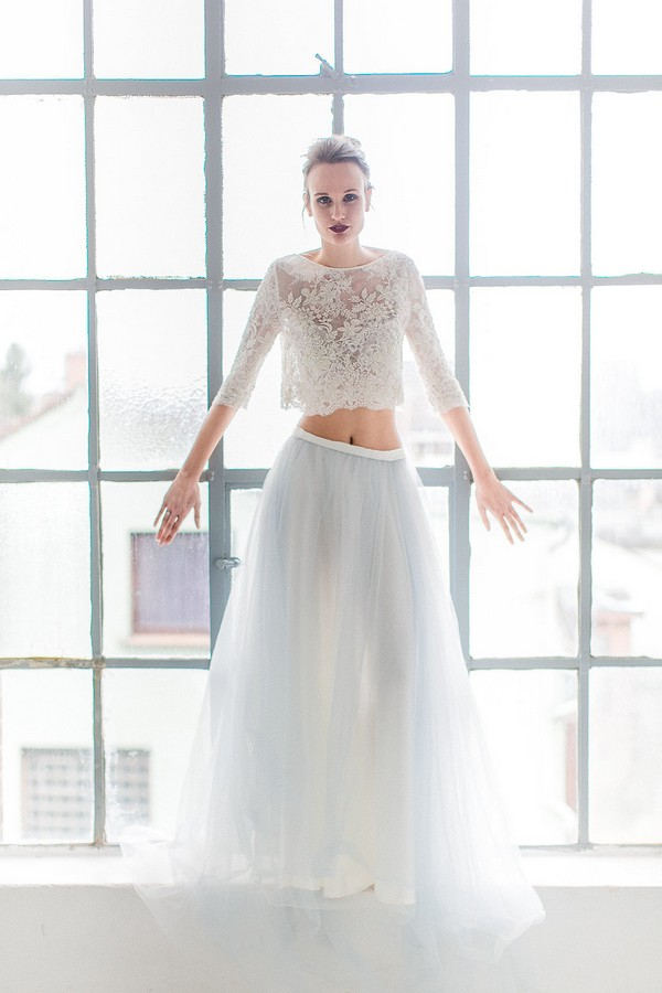 Bride standing up against window