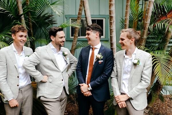 Groom with groomsmen in light grey suits