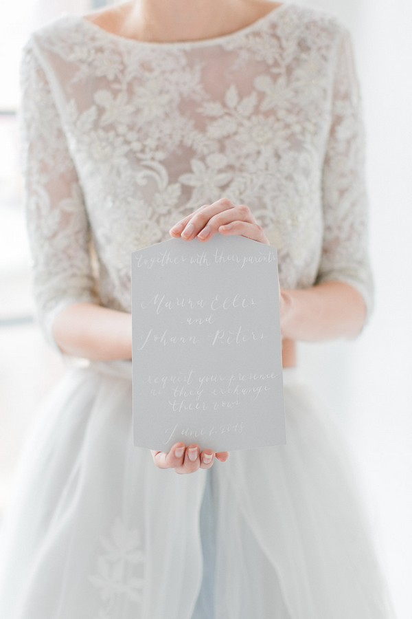 Bride holding wedding invitation