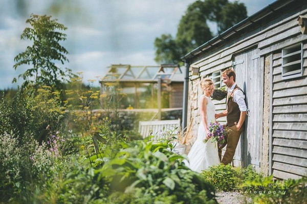 Bride and groom by shed - Picture by Lewis Fackrell Photography