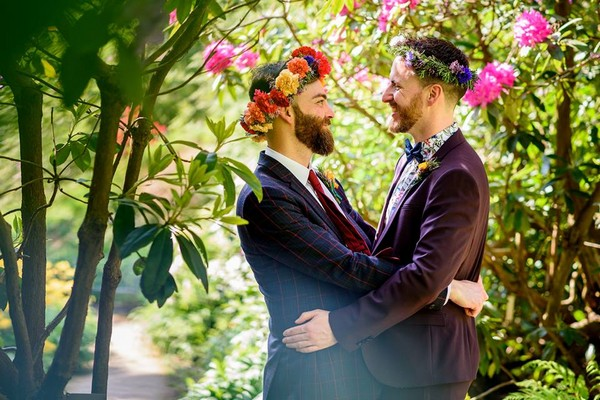 Two grooms with flower crowns facing each other - Picture by Winston Sanders Photography