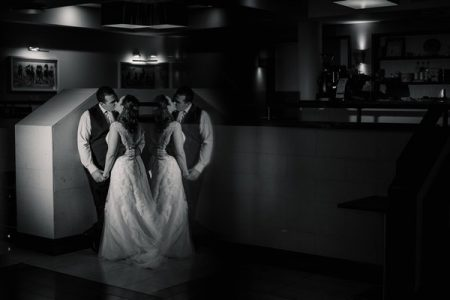 Reflection of bride and groom kissing - Picture by Becky Harley Photography