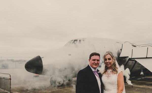 Bride and groom in front of plane - Picture by Jade Maguire Photography