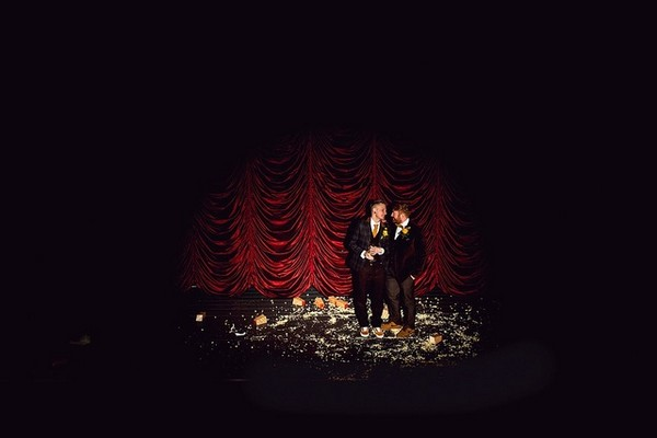 Two grooms on stage under spotlight - Picture by Daz Mack