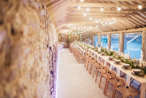 Rustic wedding styling in The Cowyard Barn at Pengenna Manor