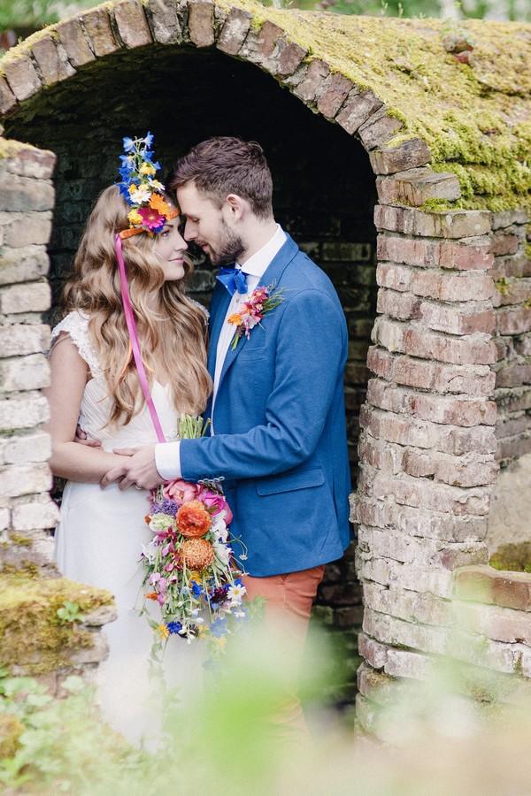 Bride and groom under brick arch