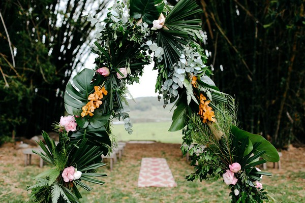 Wedding ceremony arch and rug