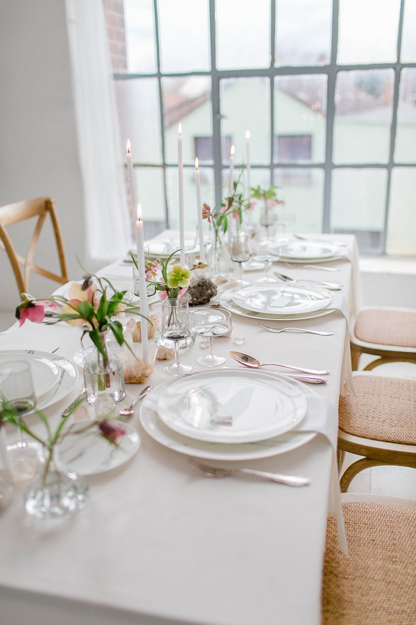 Wedding table with hellebore table flowers and quartz crystals