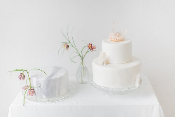 Grey marble and plain white wedding cakes