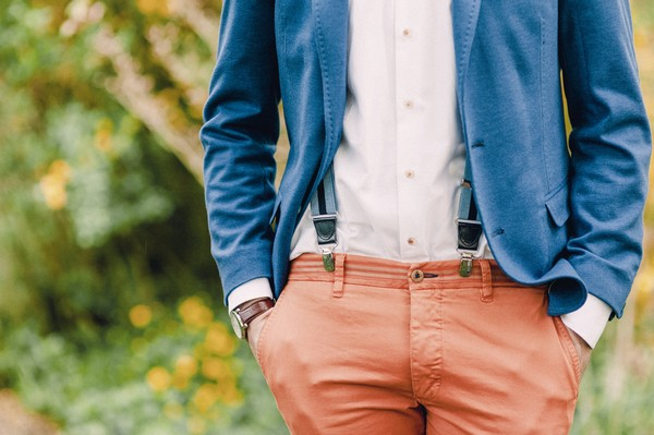 Groom's blue jacket and coral trousers