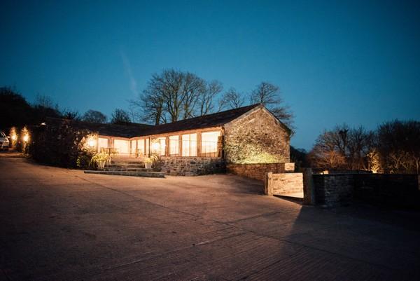 The Cowyard Barn at Pengenna Manor lit up at night