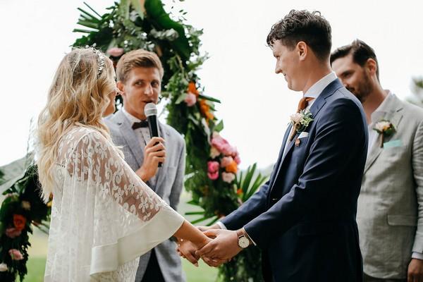 Wedding celebrant conducting ceremony
