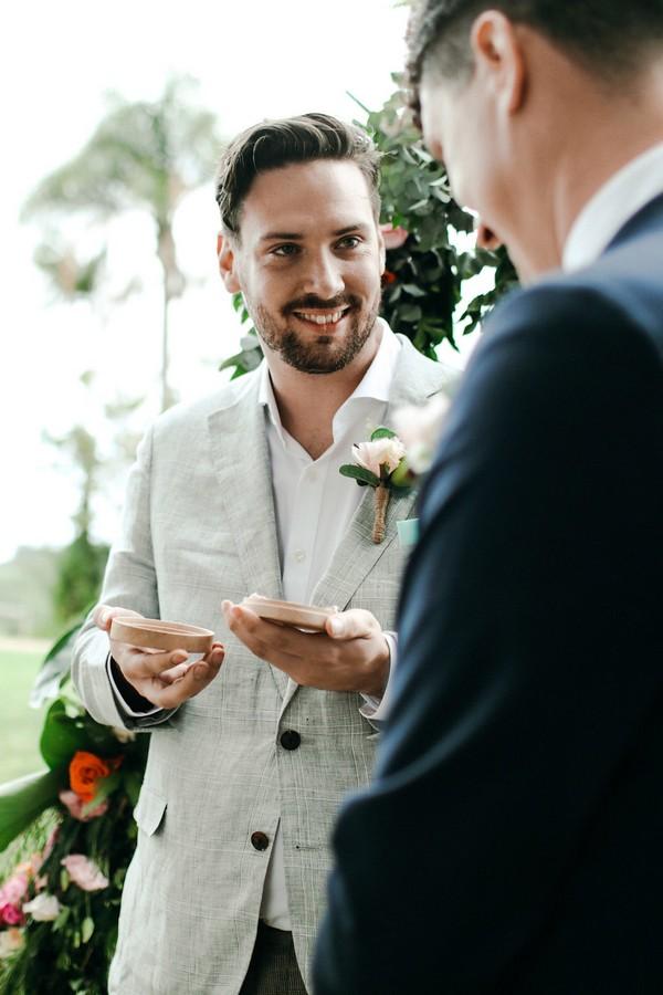 Best man giving groom wedding rings