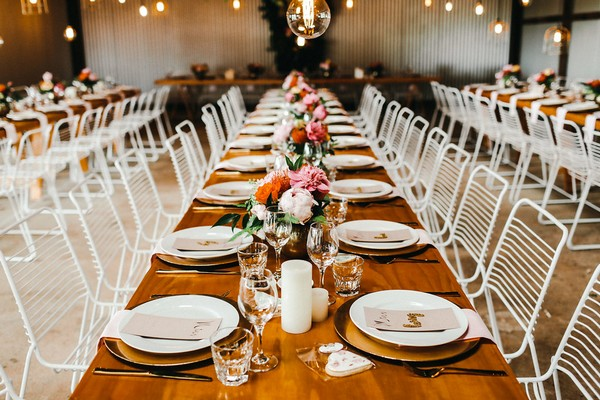 Long wedding table with flower centrepieces