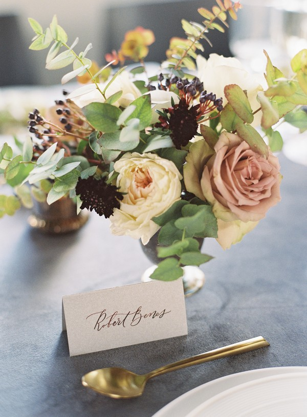 Antique toned wedding table flowers