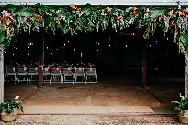 Wedding barn at Graciosa with foliage and flowers hanging from front