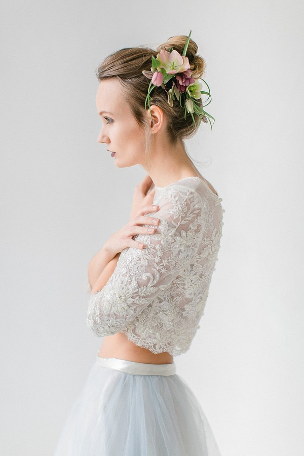 Bride wearing crop top and floral hairpiece