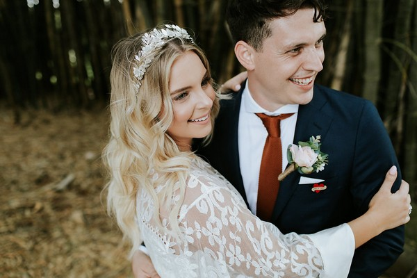 Bride smiling with groom
