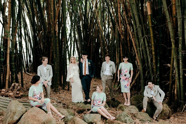 Bride and groom posing with bridal party
