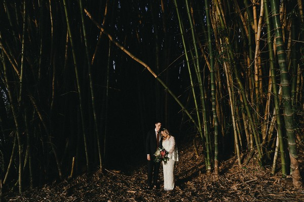 Bride and groom by tall trees at Graciosa
