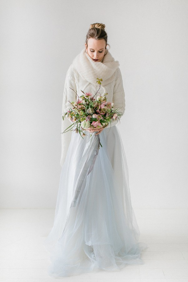 Bride with scarf holding bouquet