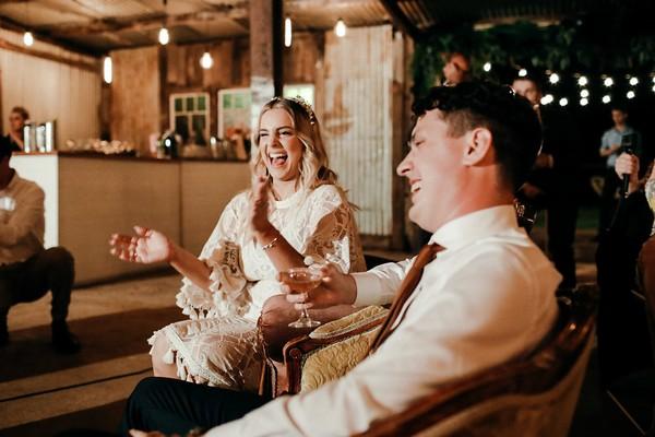 Bride and groom enjoying speech