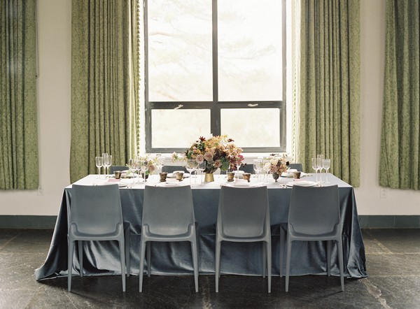 Wedding table with grey tablecloth and chairs
