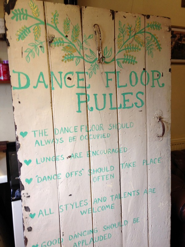 Old door with dance floor rules painted on