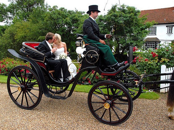 Bride and Groom in Horse-Drawn Victoria Carriage