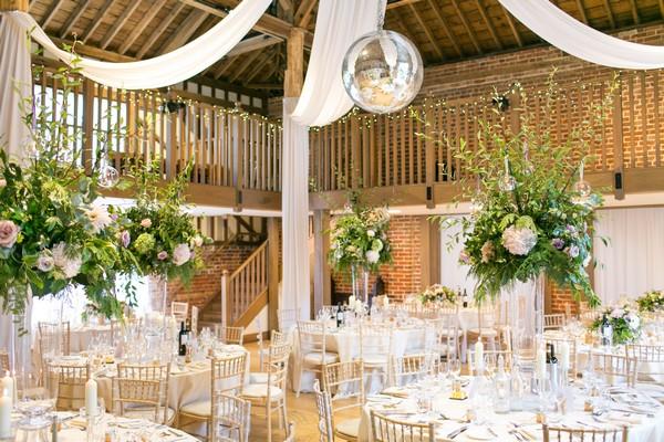 Wedding breakfast tables in Mill Barn at Gaynes Park