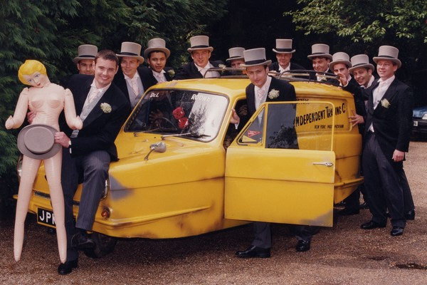 Groomsmen with Only Fools and Horses Three Wheel Van