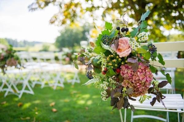 Wedding Flowers on White Folding Chair