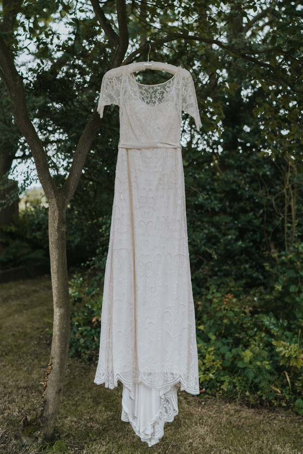 Wedding dress hanging in tree