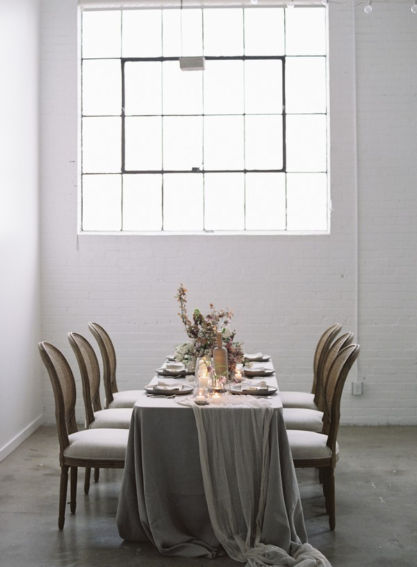 Small wedding table with grey tablecloth and tulle runner