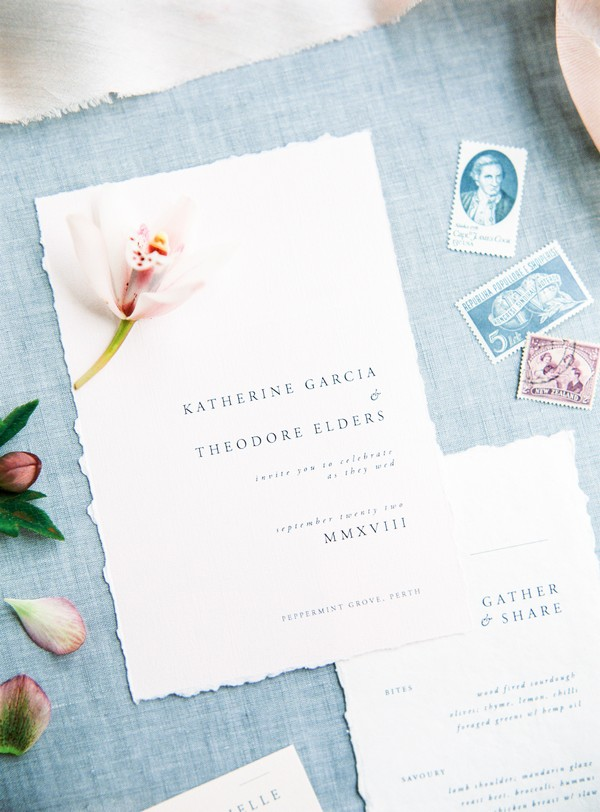 Flower on simple, elegant wedding invitation