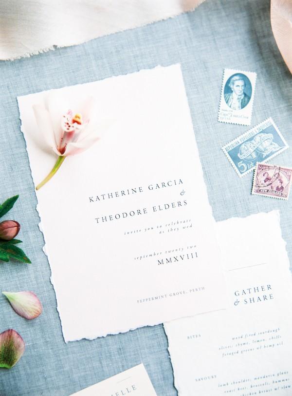 Flower on simple, elegant wedding invitation