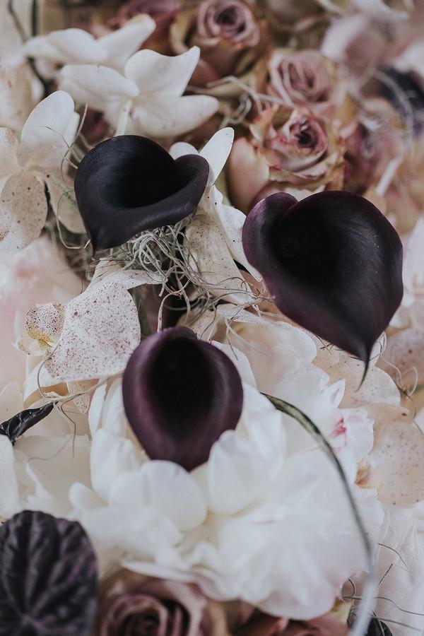 Dark calla lilies