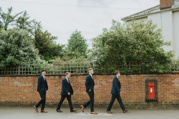 Groomsmen walking to wedding
