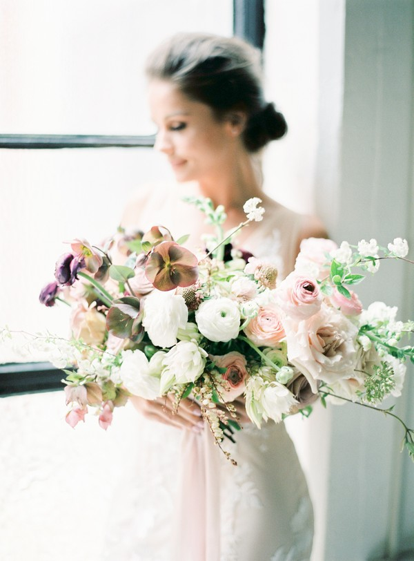 Bride holding bouquet of blush and white flowers