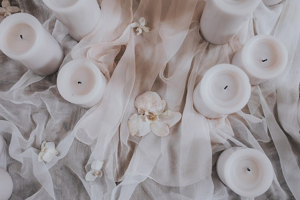 Candles on tulle tablecloth