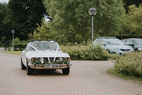 Wedding car arriving at venue