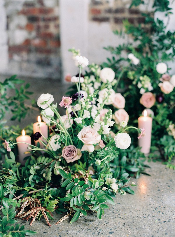 Blush and white wedding flowers amongst foliage