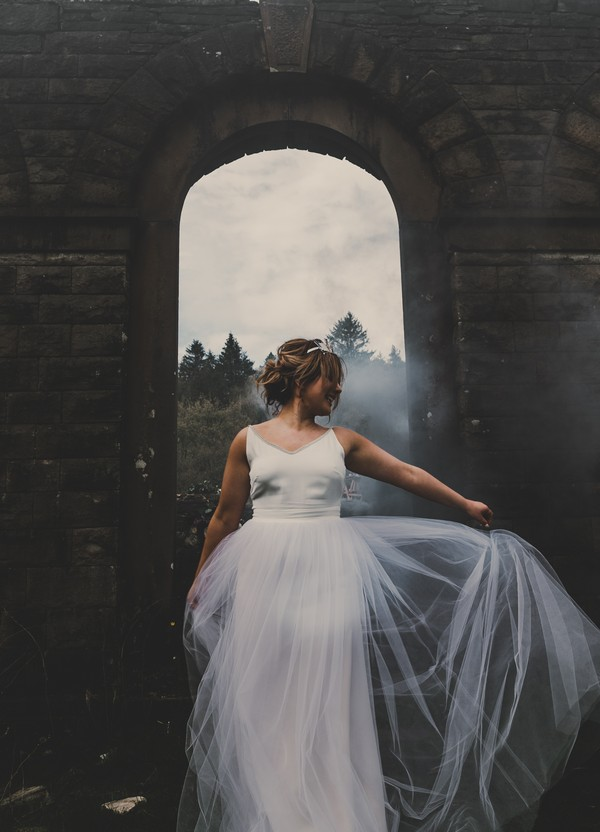 Bride holding out tulle skirt