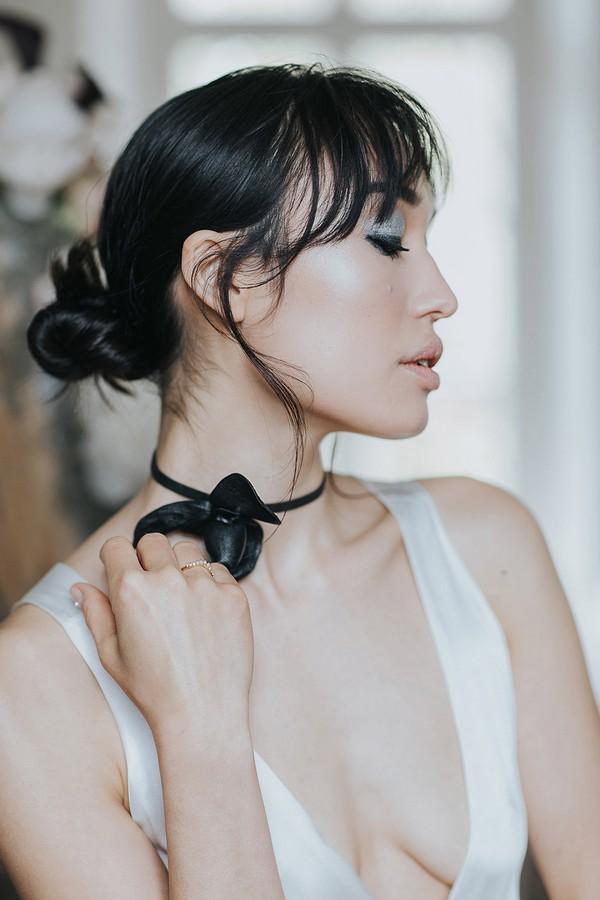 Bride with updo and dark choker neckpiece