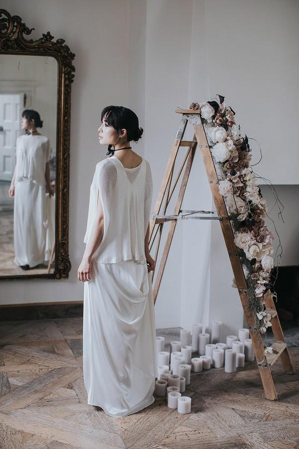 Bride wearing draping wedding dress