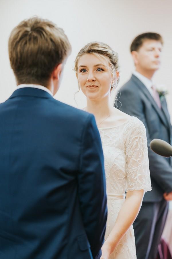 Bride facing groom