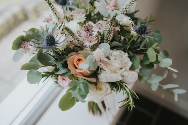 Close up of flowers and foliage in bridal bouquet
