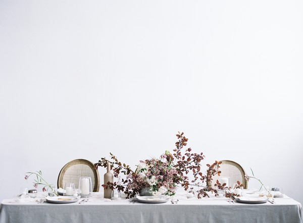 Elegant wedding tablescape with mauve and blush flowers