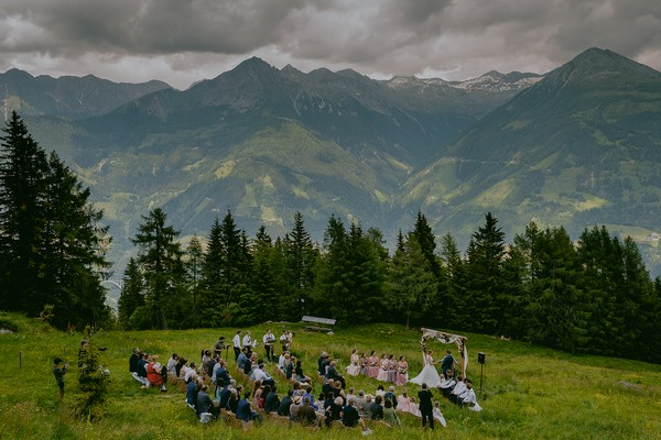 Outdoor wedding ceremony with mountains in background - Picture by Rares Ion
